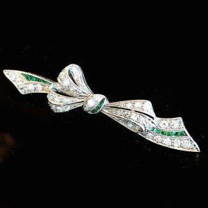 Art Deco Platinum PT950 Diamond & Emerald Ribbon bow brooch, pin Circa 1920