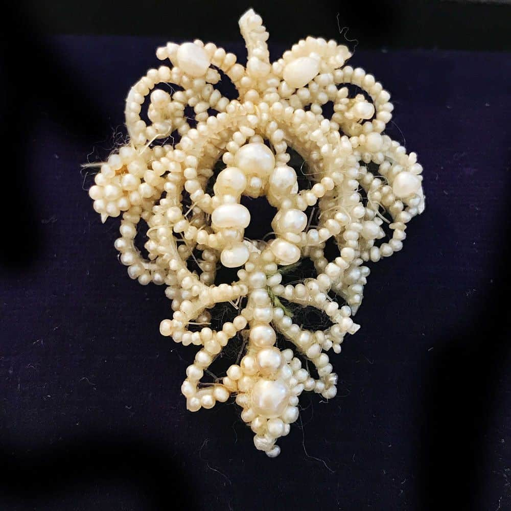 Gorgeous Georgian Natural pearl brooch in foliate design on mother of pearl back