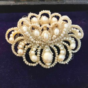 Gorgeous Georgian Natural pearl brooch in lily design with mother of pearl back