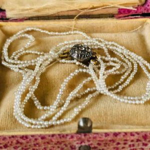 Antique, Georgian natural basra seed pearl necklace on black dot paste clasp
