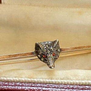 Two, Edwardian fox tie pins in gold, diamond & Ruby in Garrards box.