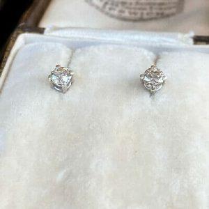 Stunning, Pair of Platinum Diamond (0.44ct) solitaire stud earrings
