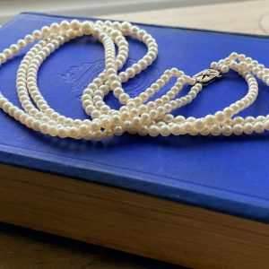 Vintage, Cultured Saltwater Pearl necklace on 9ct diamond clasp, Dated 1979