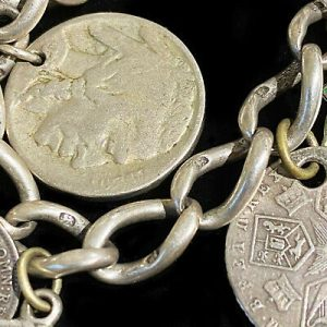 Antique, Silver curb bracelet with twelve coin charms dated 1826 to early 1900s