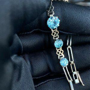 "Fine Edwardian 9ct/9k, white Gold, blue Zircon articulated bracelet, Length 7.5"""