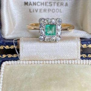 Art Deco 18ct Gold and Platinum Emerald & diamond cluster ring, circa 1920