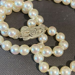 Fine quality, Mikimoto cultured, saltwater, uniformed row of pearls - hallmarked