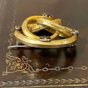 Victorian Gold pinchbeck and flat backed garnet, knot brooch, Circa 1880