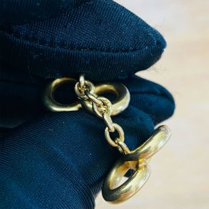 Edwardian 18ct, 18k, 750 Gold infinity cufflinks with chain fittings, Circa 1905