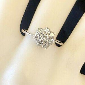 Art deco, Platinum, Diamond (0.53ct), Daisy, cluster engagement ring, Circa 1935