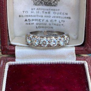 An 18ct,18k, 750 white gold, Diamond half eternity, anniversary, wedding ring
