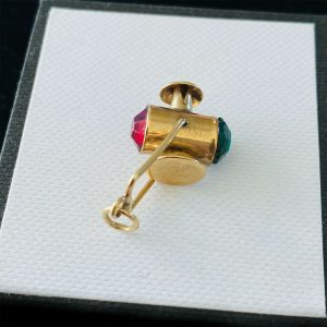 Vintage 9ct/9k, yellow gold railway lamp charm, pendant with green & red stones