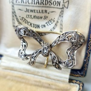 Belle epoque 18ct gold & silver old-cut Diamond bow, brooch with suspension loop