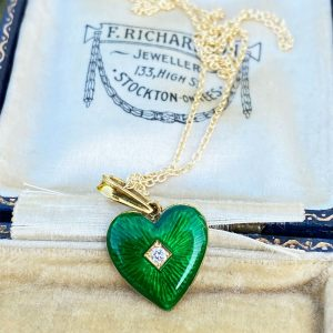 An 18ct, 18k, 750 Gold, Guilloche Enamel & Diamond heart pendant, on 9ct chain